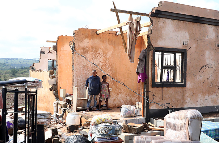 Bandile and Asanda Xulu outside their grandmother's home in eMpolweni, near Pietermaritzburg, which collapsed after being hit by a tornado in November.