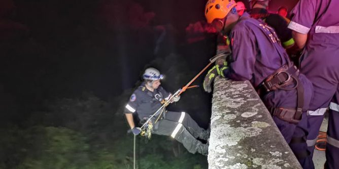 Rescuers had to abseil 30 metres down into a valley to rescue a woman who fell off a bridge outside Durban.