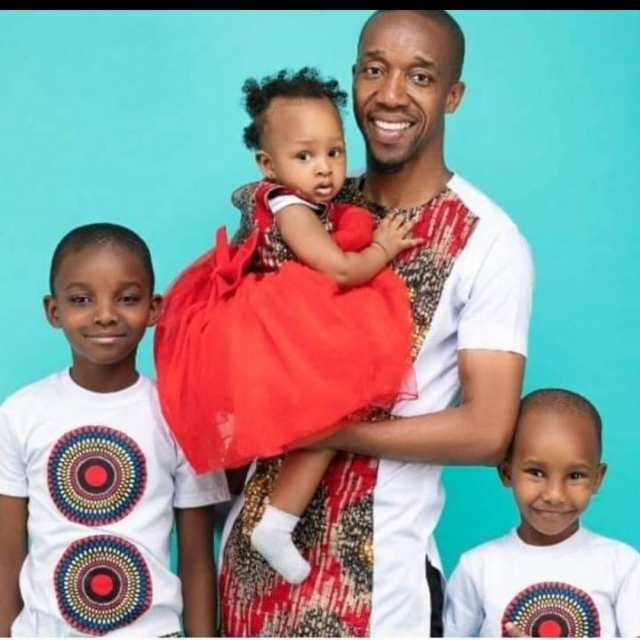 Father of the year' Rashid Abdalla poses with his 3 adorable kids